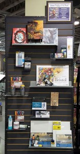 An endcap at Binders sells the materials used by an employee to create art.