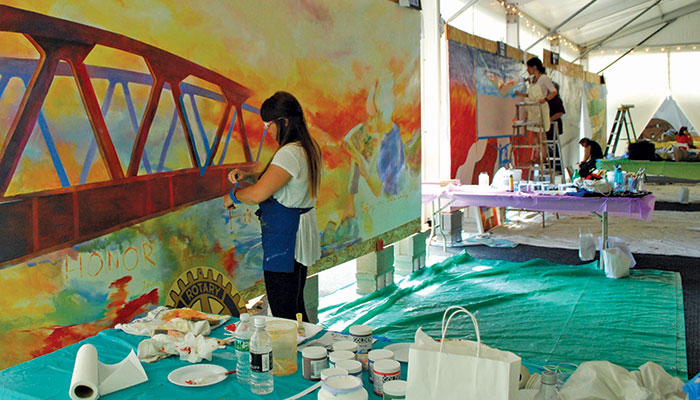 At this year's Global Mural Conference, Fernanda Gonzalez Lattrecchiana from Buenos Aires was among a dozen sponsored artists who created murals of scenes along the Erie Canal.